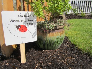 Homeowners who pledged to avoid weed and feed put up free lawn signs to encourage their neighbors to do the same.