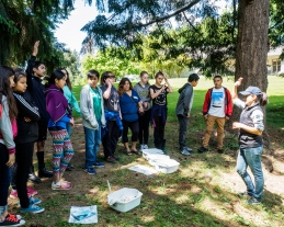 Kellyn Baez teaches about aquatic macroinvertebrates - Tualatin River Farm watershed field trip program, photo John Driscoll