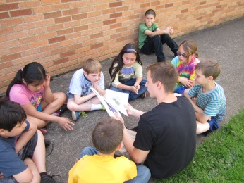 High school students teach elementary students about water quality