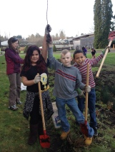 Students maintain their school rain garden