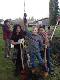 Students maintain their school rain garden
