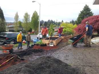 Participants work together to improve soil infiltration and reduce runoff generation at installation workshop