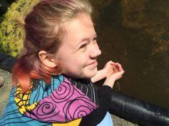 student captures an aquatic salamander