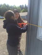students measure impervious surface area to calculate rain garden size