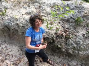 Jamie plants a tree on Earth Day